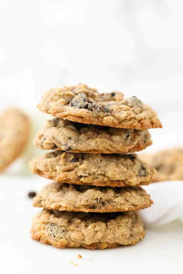 A stack of 4 thick oatmeal raisin cookies
