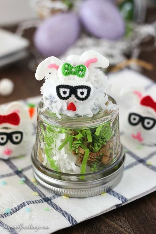 A glass jar with an Easter Bunny truffle on top