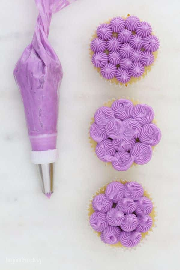 a French star piping tip used in 3 ways to show decorated cupcakes