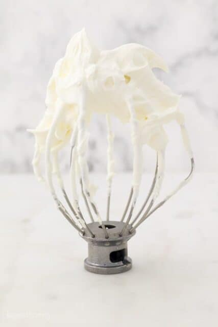 A KitchenAid wire whisk with Mascarpone Whipped Cream