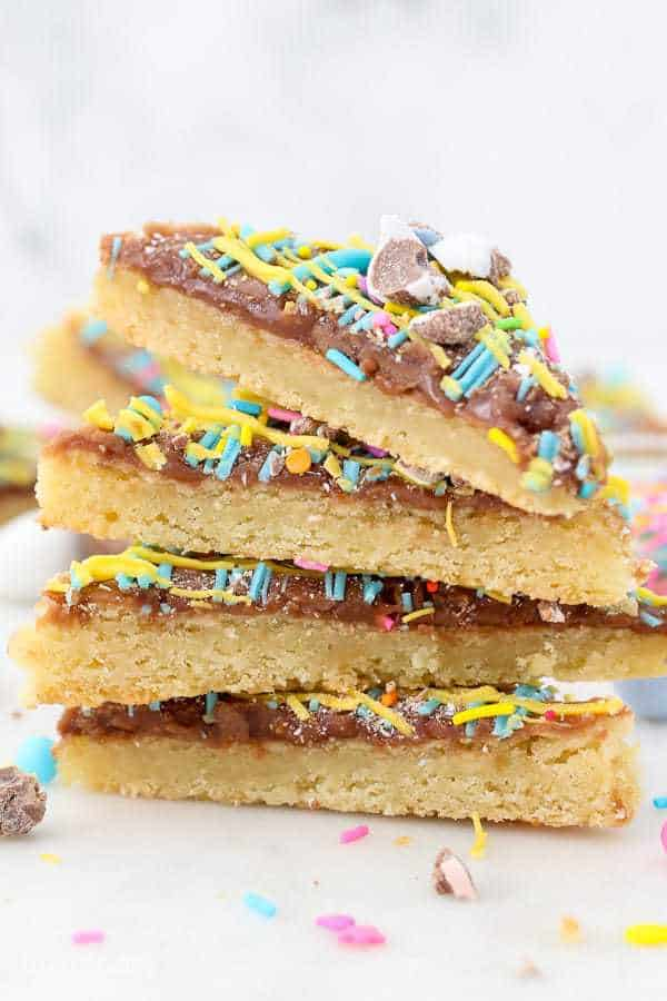 A stack of 4 Easter sugar cookie bars with sprinkles on top