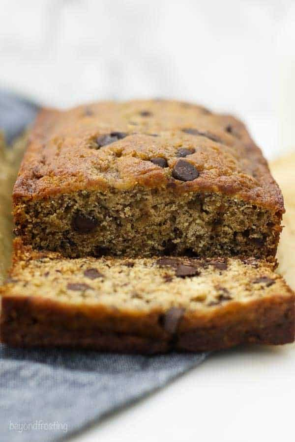 A loaf of chocolate chip banana bread with one slice missing