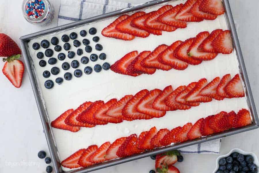 an overhead shot of a cake decorated to look like an American flag