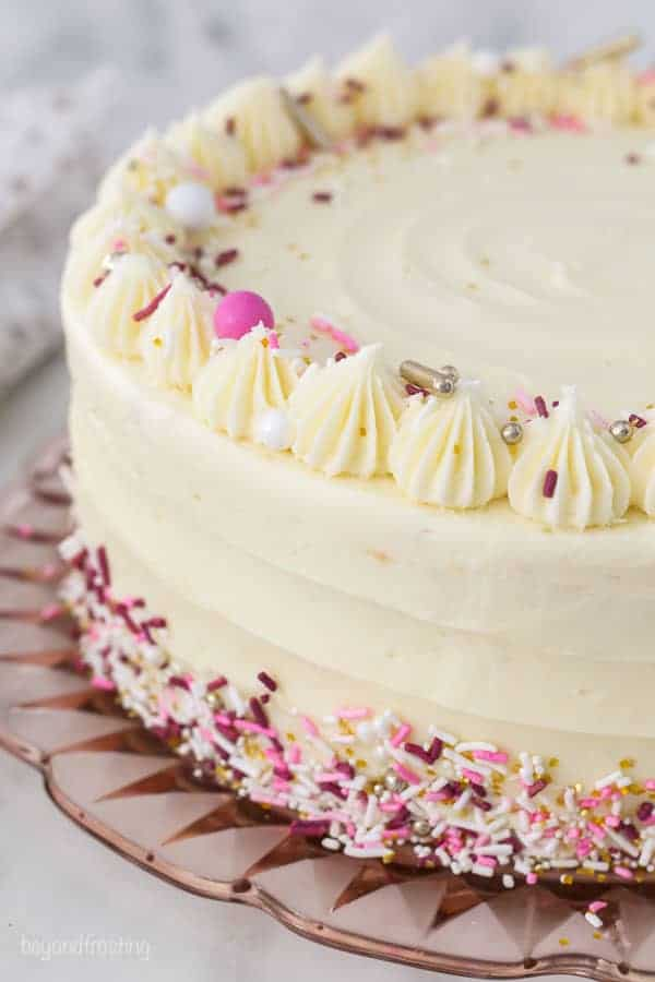 A gorgeous frosted cake with pink and white sprinkles