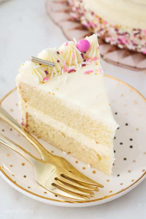 A slice of vanilla cake with pink sprinkles