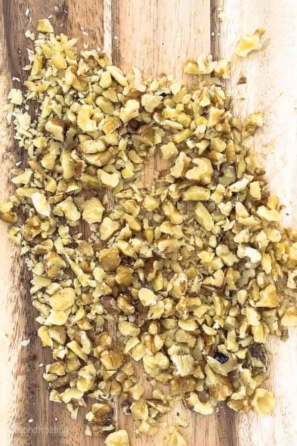 diced walnuts on a cutting board