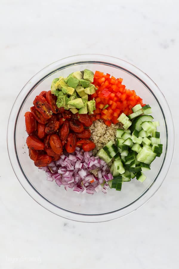 an overhead shot of a bowl of fresh chopped vegetables