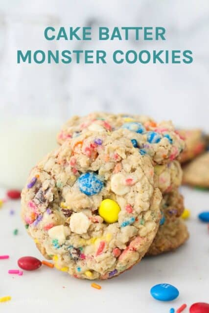 A colorful oatmeal cookie leaning up against a stack of cookies with text overlay