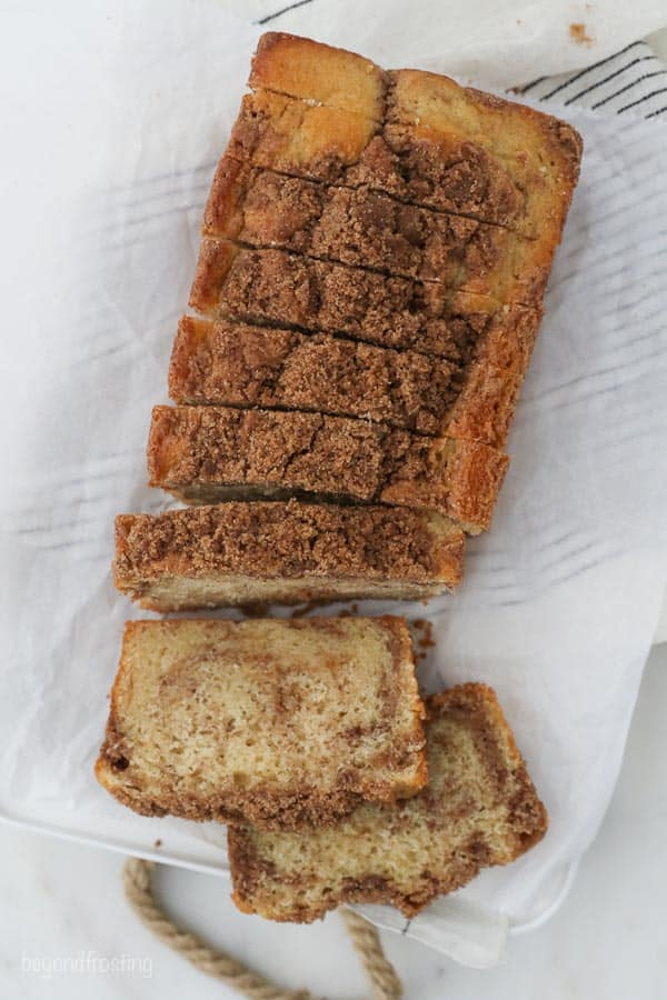 an overhead shot of a loaf of cinnamon sugar bread that is sliced