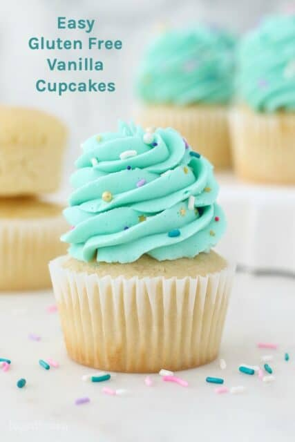 A vanilla cupcake with teal frosting and sprinkles and a text overlay