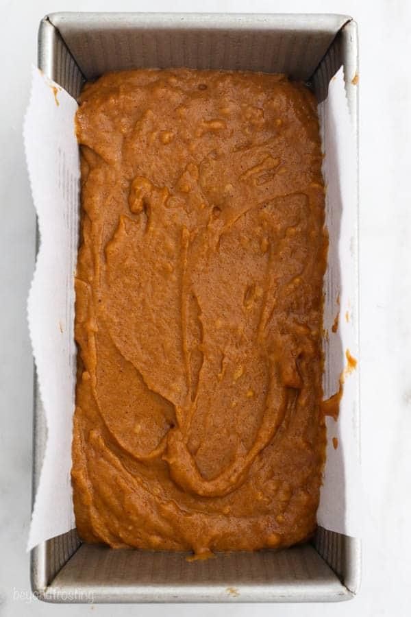 overhead shot of pumpkin bread batter in a loaf pan