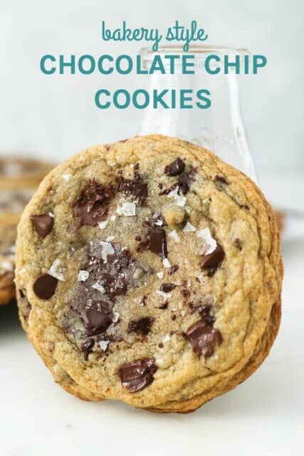 A chocolate chip cookie leaning up against a milk glass with a text overlay