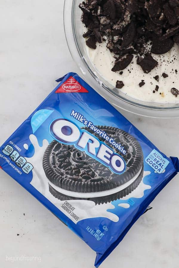 An overhead shot of a package of Oreos with a mixing bowl to the side