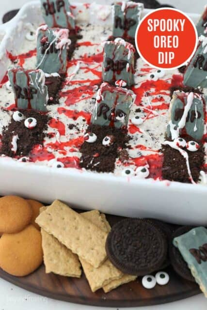 A Oreo dessert dip decorated for halloween with a text overlap