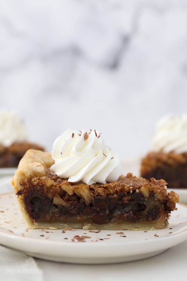 A side view of a slice of chocolate walnut pie