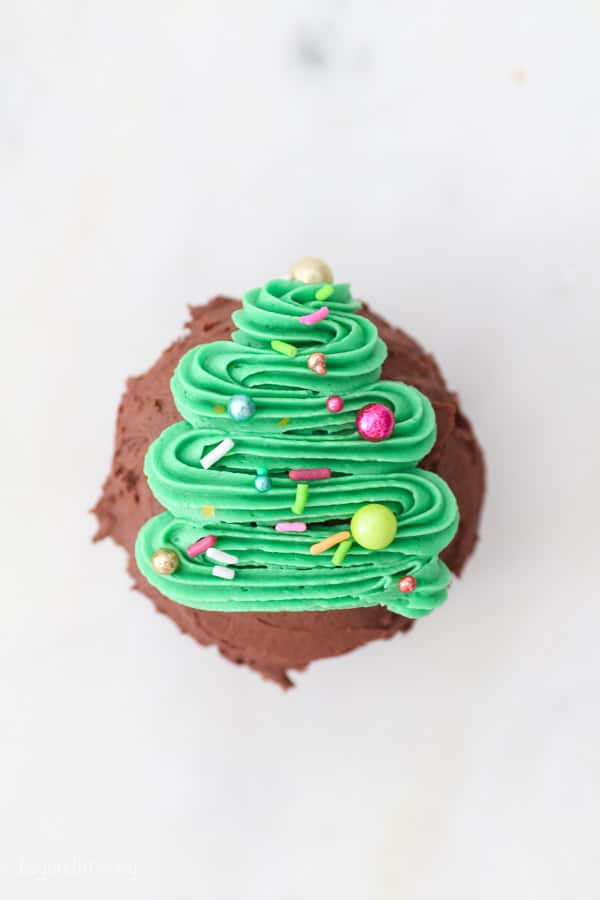 top down view of a cupcake decorated with a Christmas tree and sprinkles