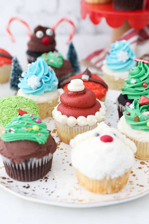 a gorgeous plate of Christmas themed cupcakes
