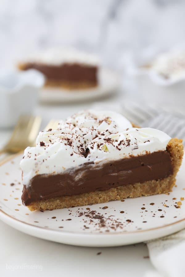 a slice of chocolate pudding pie topped with whipped cream
