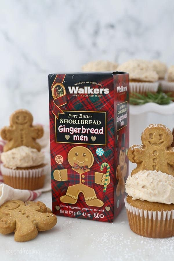 A box of Walkers Gingerbread Men Shortbread cookies along side Gingerbread cupcakes