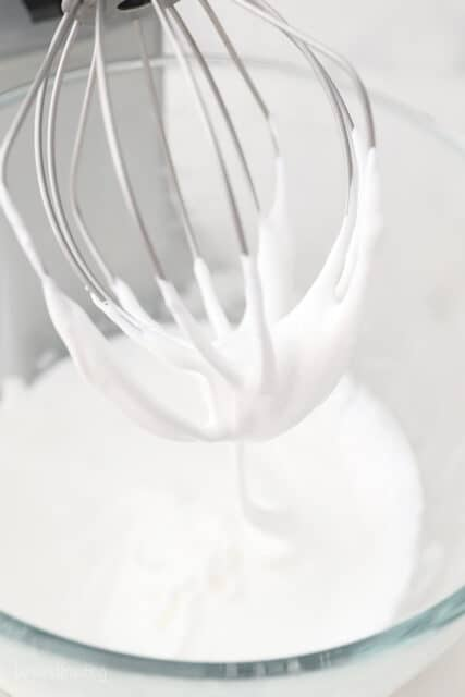 Whisk attachment of stand mixer with meringue frosting