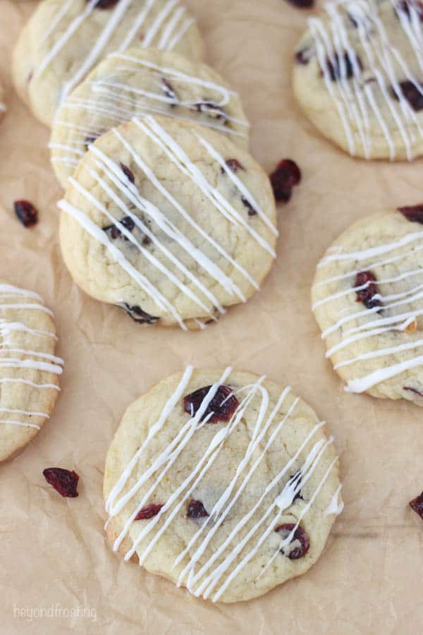 overhead shot of cranberry orange cookies on brown parchment paper