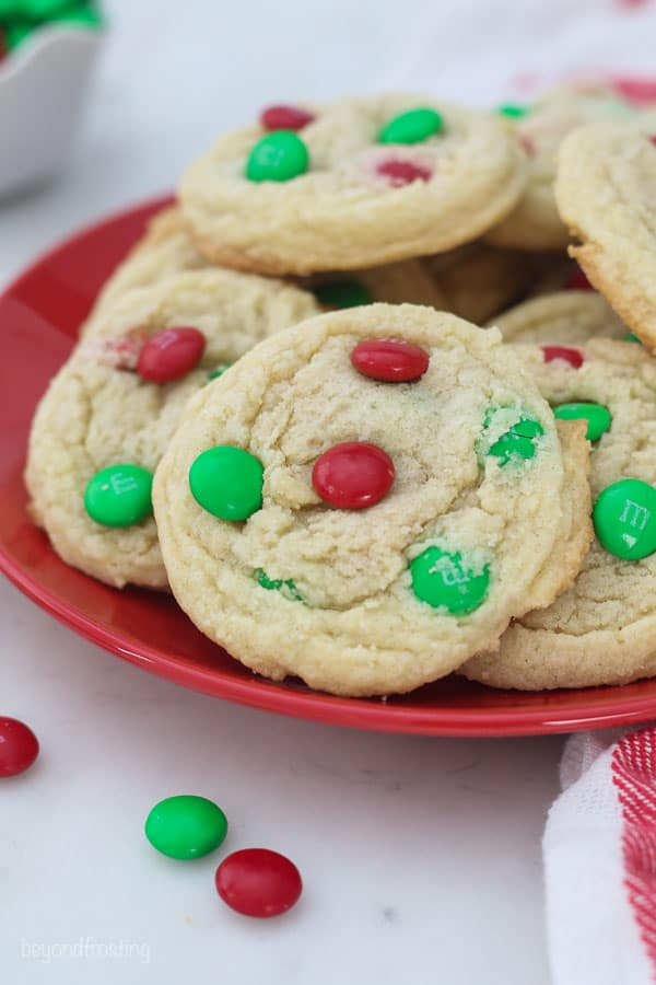 M&M cookies with red and green M&M for Christmas on a red plate
