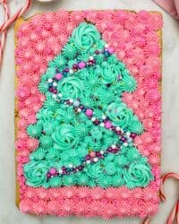 overhead shot of sugar cookie bar decorated with a buttercream Christmas tree
