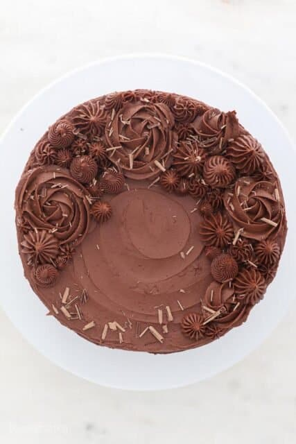 a top view of a decorated cake with chocolate frosting