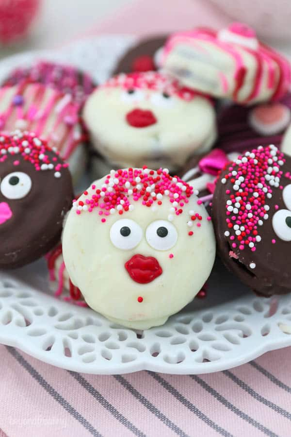 Oreos decorated with sprinkles, googly eyes and sprinkles for Valentine's Day