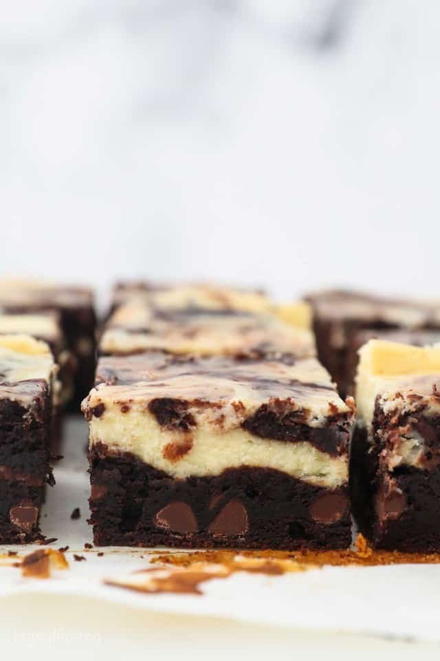 side view of a sliced cheesecake brownie