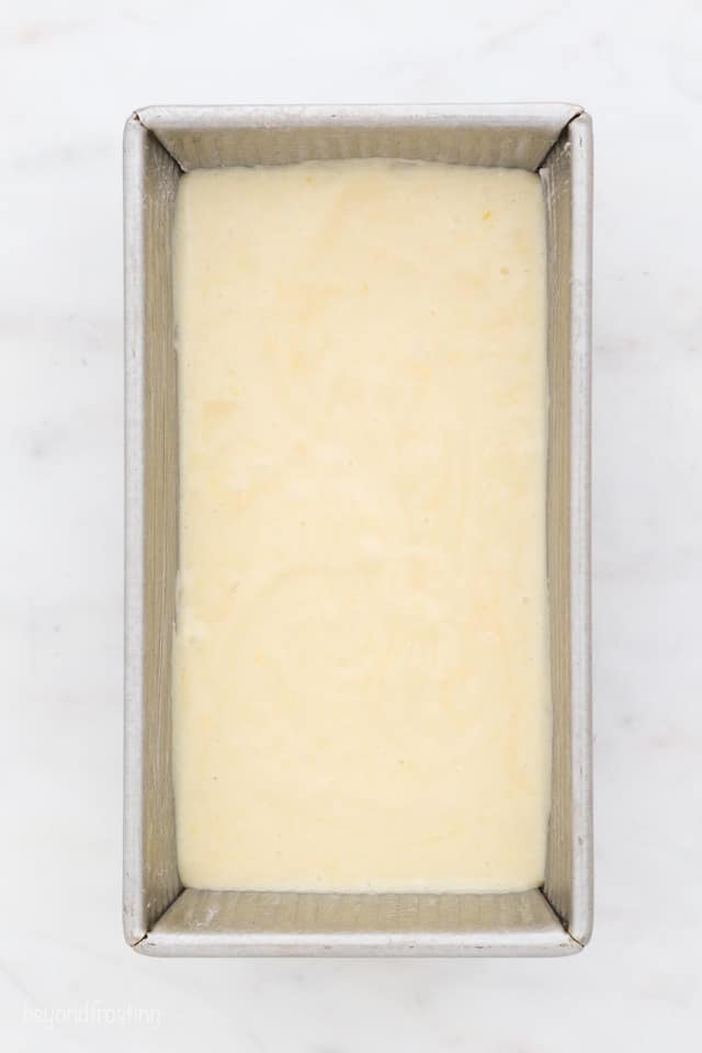 overhead shot of a loaf pan filled with batter