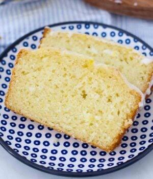 two slices of lemon bread on a blue polka dot plate