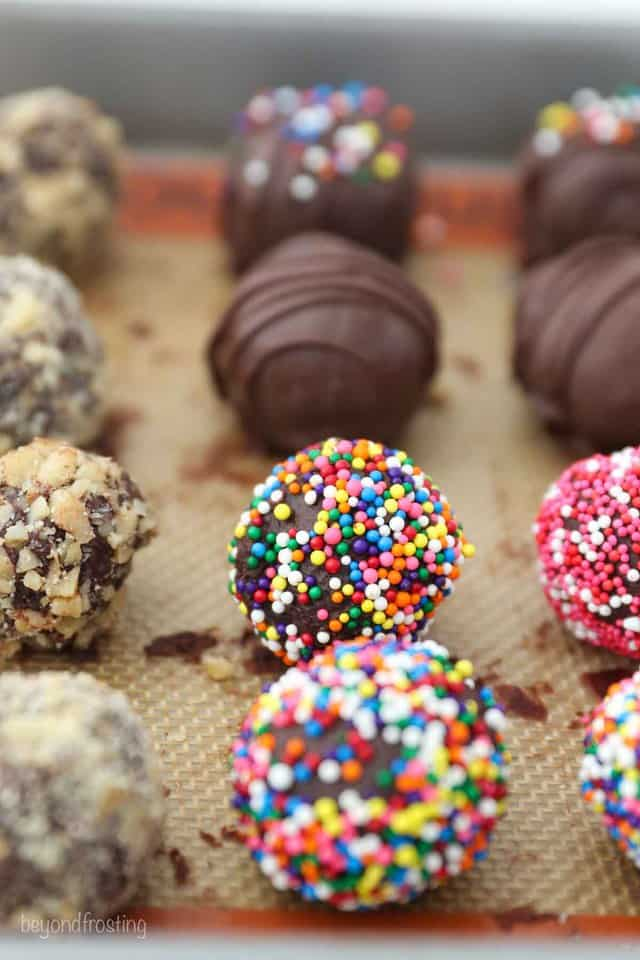 Decorated Truffles Lined up in Rows on a Baking Sheet