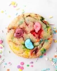 Overhead shot of Lucky charms cookie surrounded by sprinkles