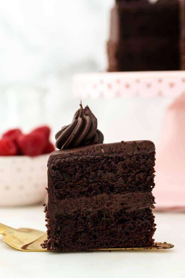 A Piece of Mini Chocolate Cake on a Golden Dessert Spatula