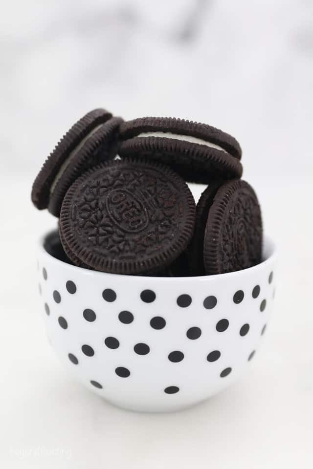 Oreo Sandwich Cookies in a White Bowl with Black Polka Dots