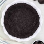 A Bird's Eye View of an Oreo Cookie Crust Pressed Into a Pie Plate
