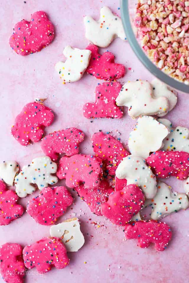 white and pink circus animal cookie spread on a pink tye dye surface