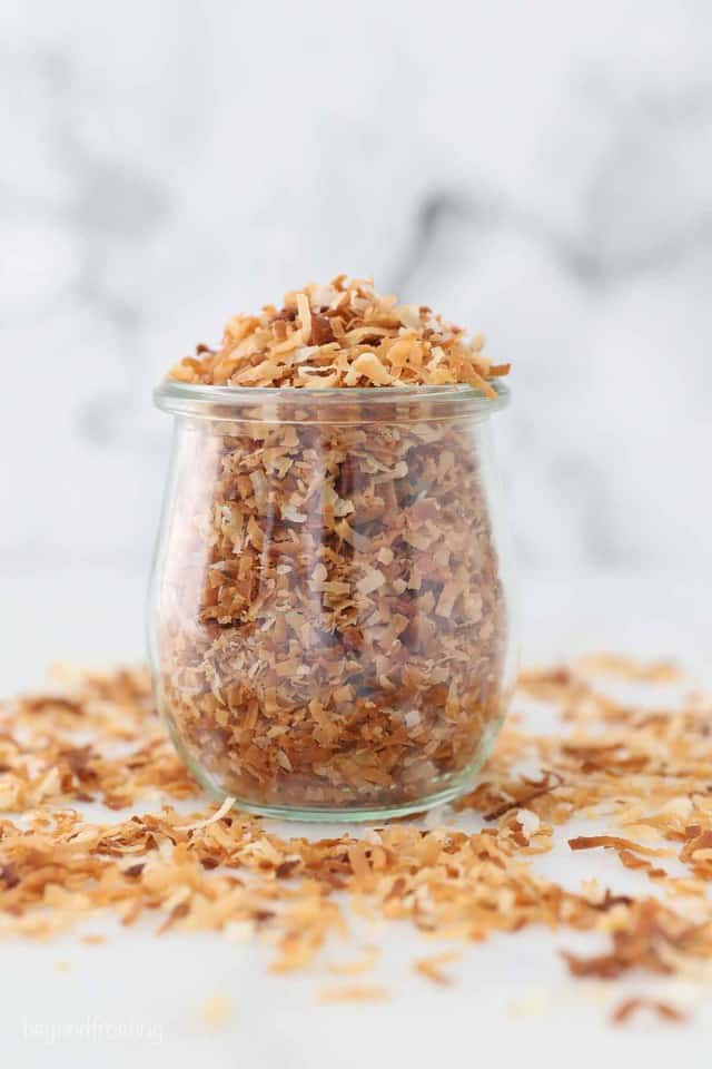 A jar filled with toasted coconut