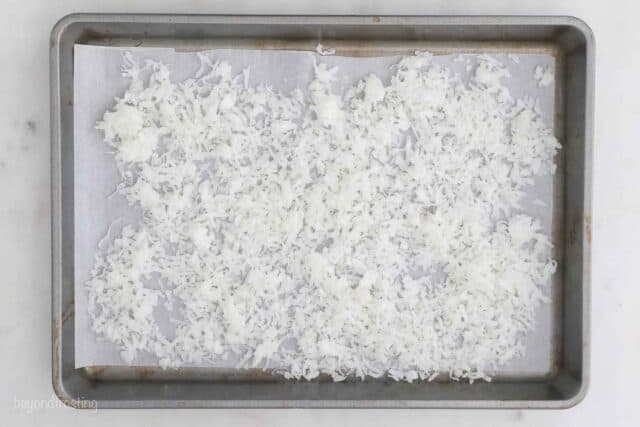 coconut on a sheet pan lined with parchment paper