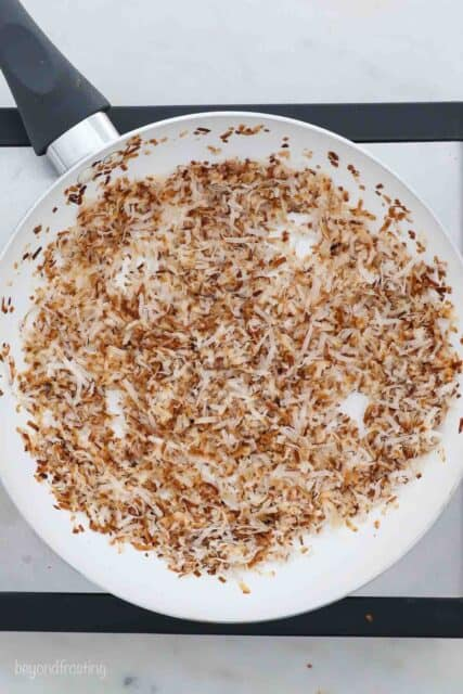 an overhead shot of a skillet filled with toasted coconut