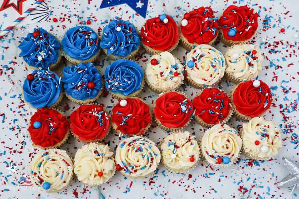 Birds eye view of decorated cupcakes laid out in the shape of a flag