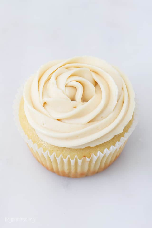 A vanilla cupcake frosted with a vanilla buttercream rose