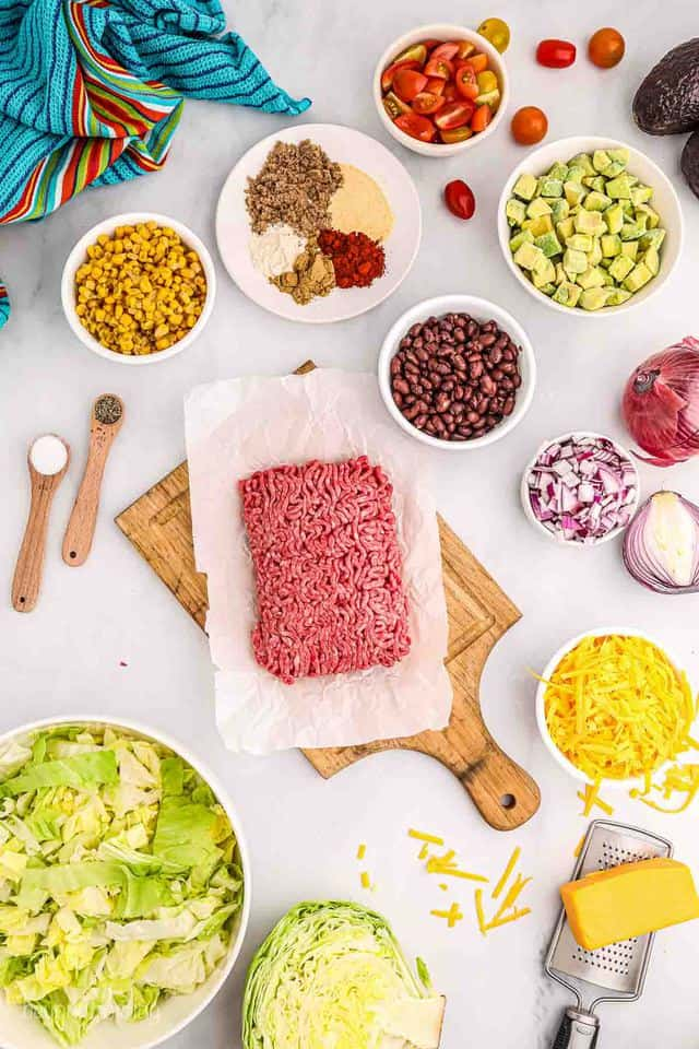 Ingredients for Taco Salad measured in serving dishes