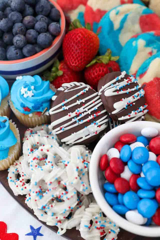 A close up shot of Patriotic colored dessert board with Oreos, Pretzels and M&Ms