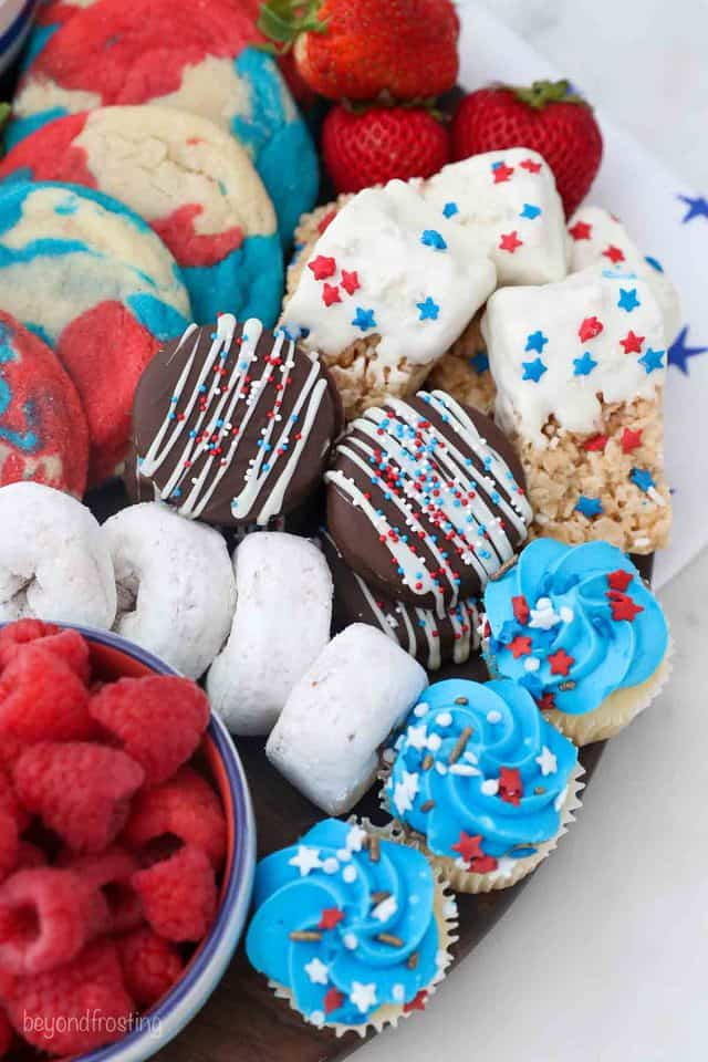 An overhead shot of a Patriotic dessert board filled with sweet treats