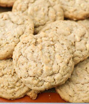 Freshly baked peanut butter oatmeal cookies on a baking sheet