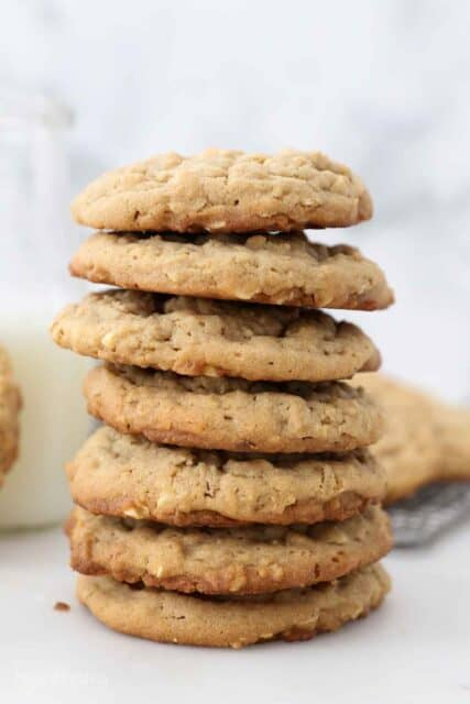 Several peanut butter cookies stacked on top of each other