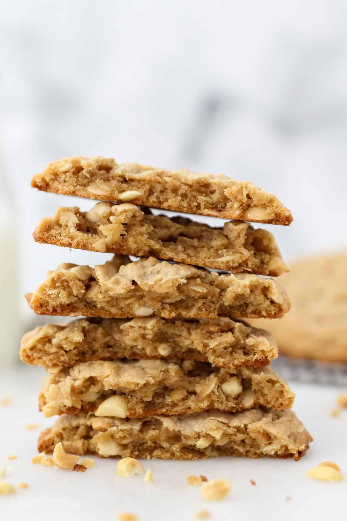 A stack of peanut butter oatmeal cookies that have been cut in half