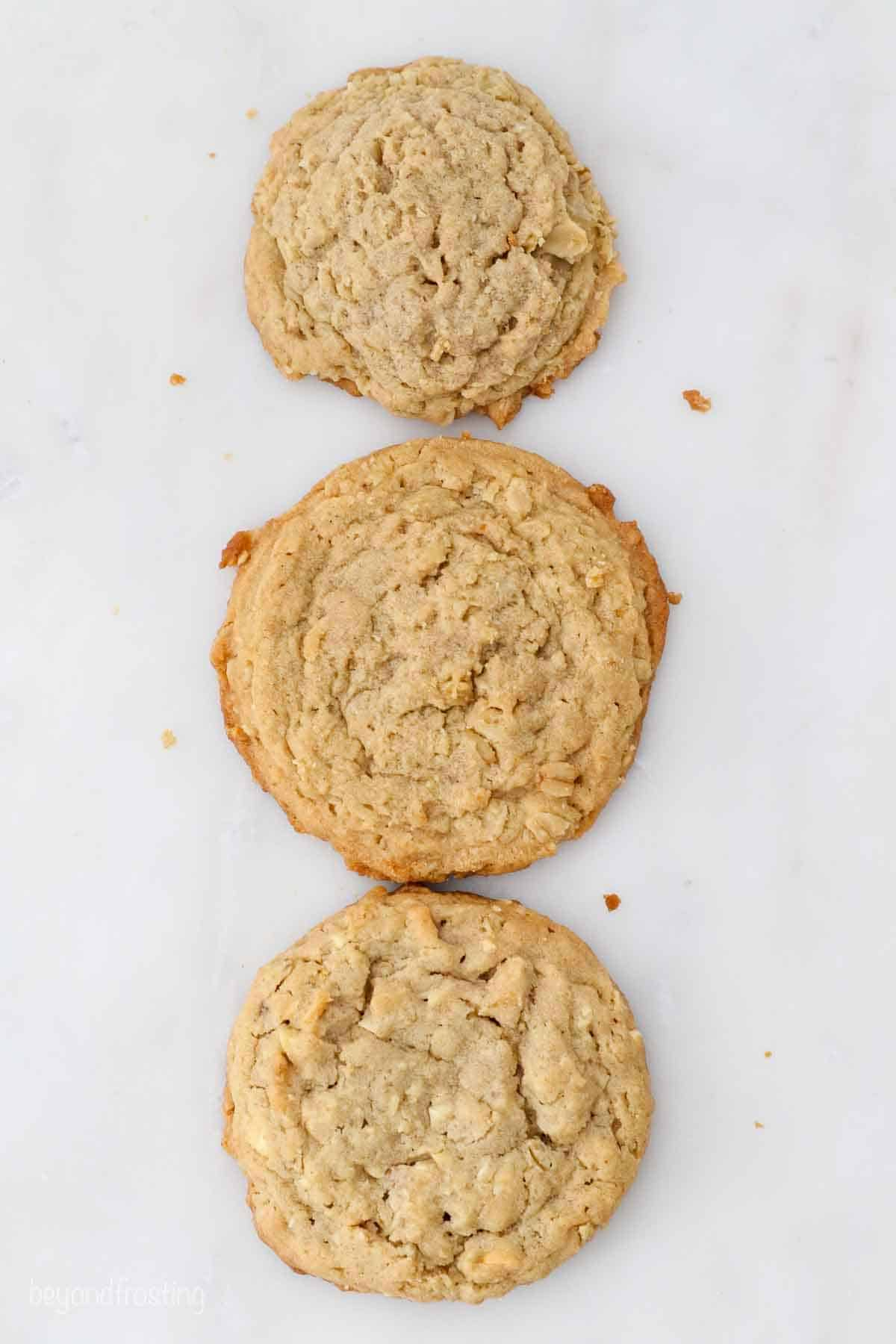 3 oatmeal cookies of varying puffy-ness